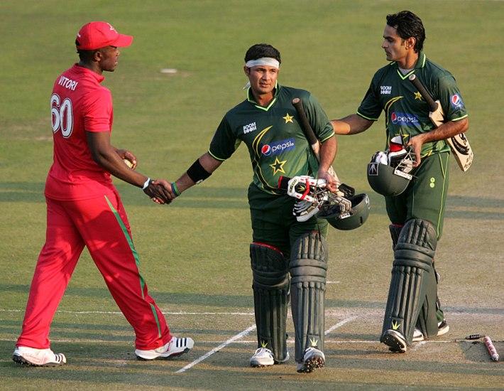 Brian Vitori congratulating Pakistani openers